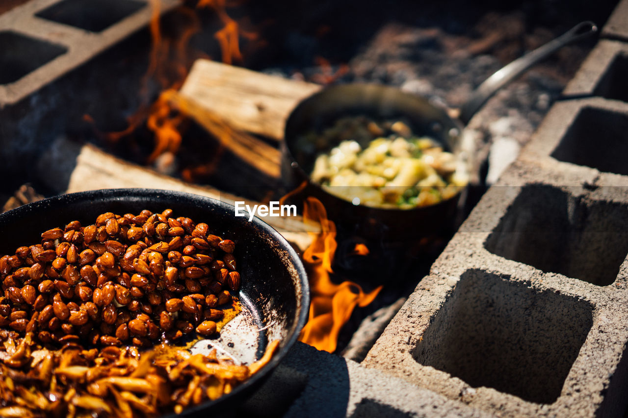 food and drink, food, freshness, preparation, no people, kitchen utensil, container, high angle view, close-up, focus on foreground, indoors, heat - temperature, still life, selective focus, day, fire, healthy eating, burning, preparing food, snack