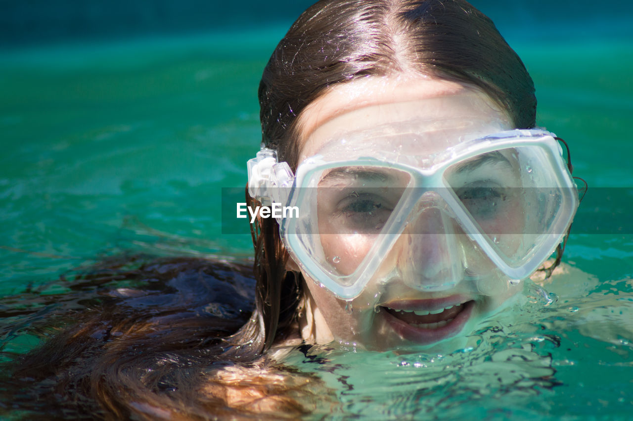 Close-up portrait of woman enjoying in swimming pool