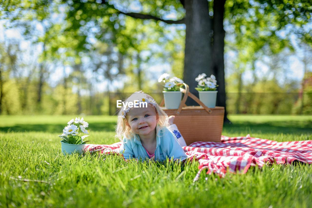 Portrait Of Girl On Grass