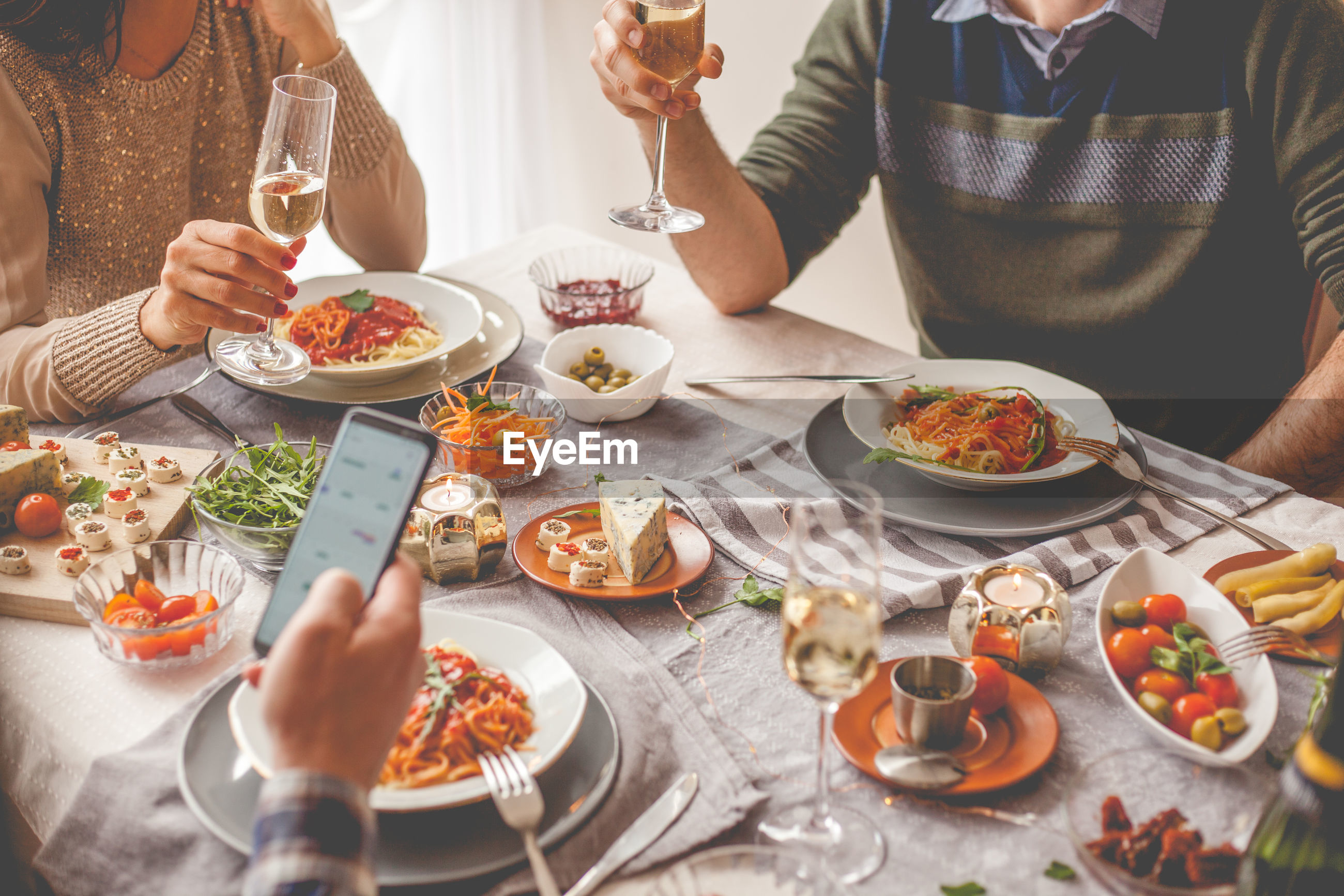 Midsection of people having food at table