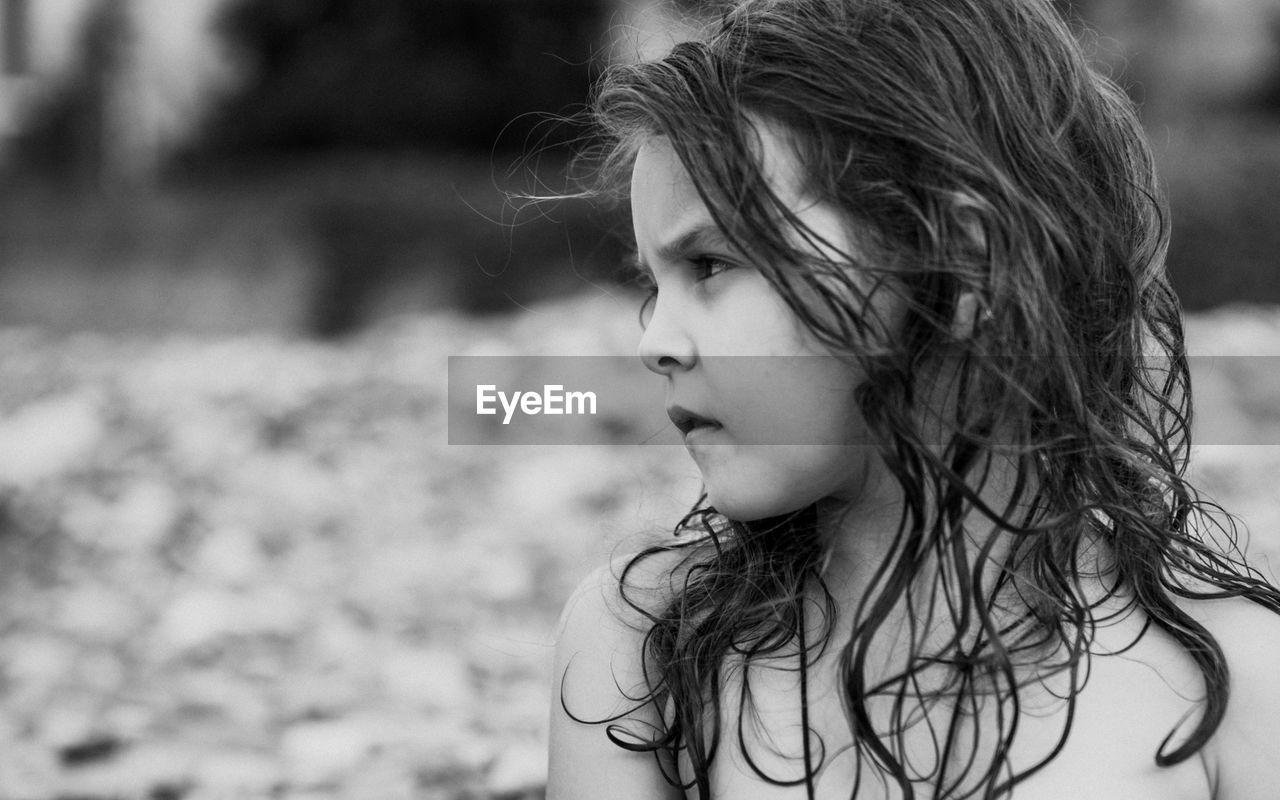 Close-Up Of Serious Girl Looking Away