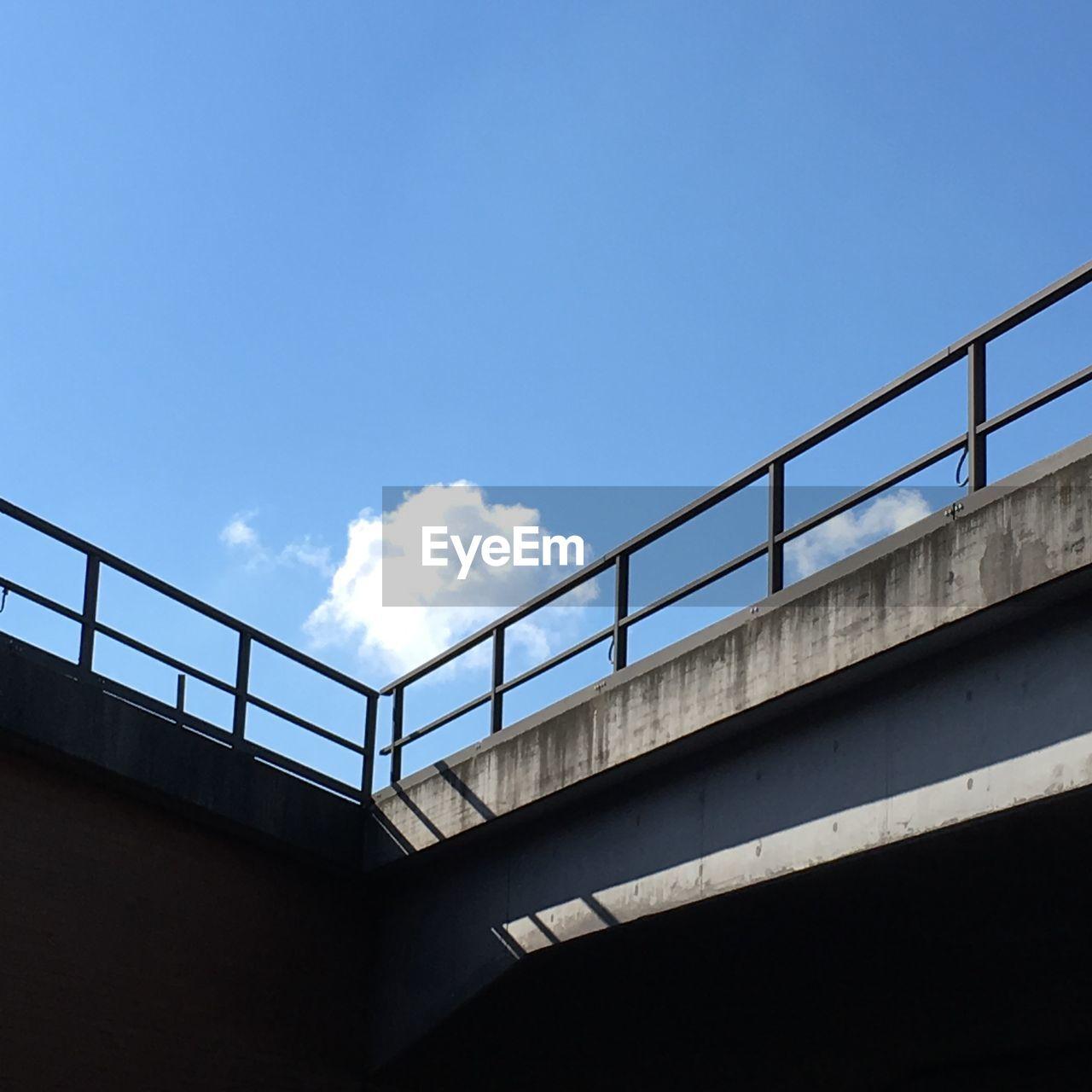 Low angle view of bridge against sky in berlin südkreuz