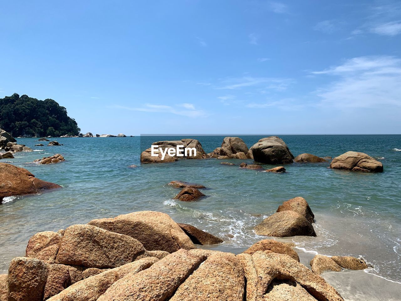 water, sea, rock, sky, solid, rock - object, beauty in nature, scenics - nature, horizon, horizon over water, tranquil scene, tranquility, nature, beach, land, cloud - sky, day, rock formation, blue, no people, outdoors, rocky coastline