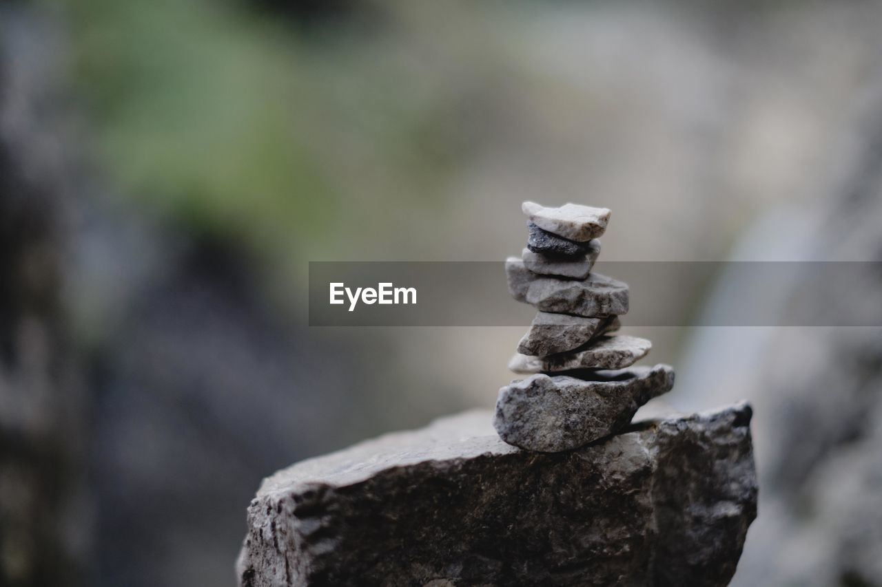 focus on foreground, balance, stack, rock, stone - object, solid, day, close-up, no people, nature, rock - object, zen-like, outdoors, selective focus, stone, textured, rough, stability, tree, tranquility