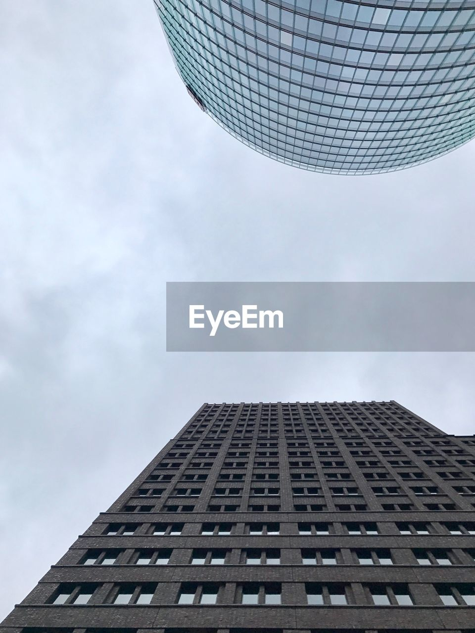 architecture, building exterior, low angle view, built structure, skyscraper, sky, day, outdoors, no people, city, modern