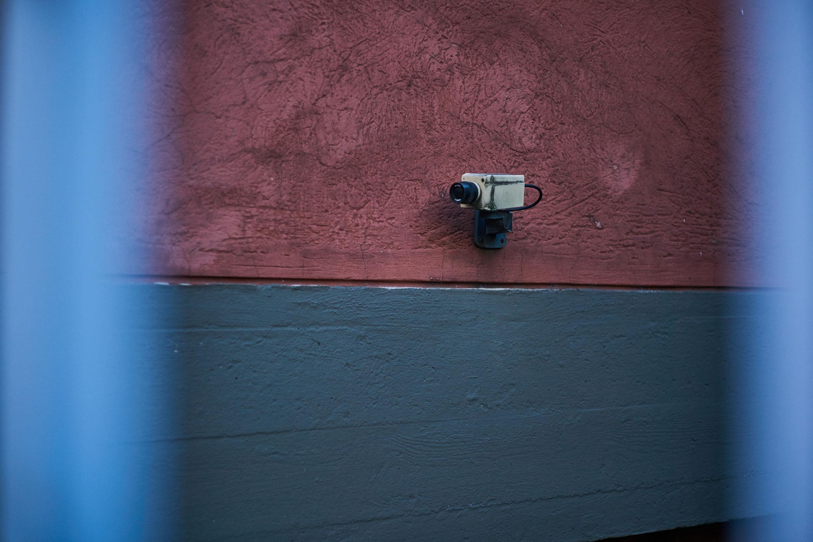 Close-up of camera on wall