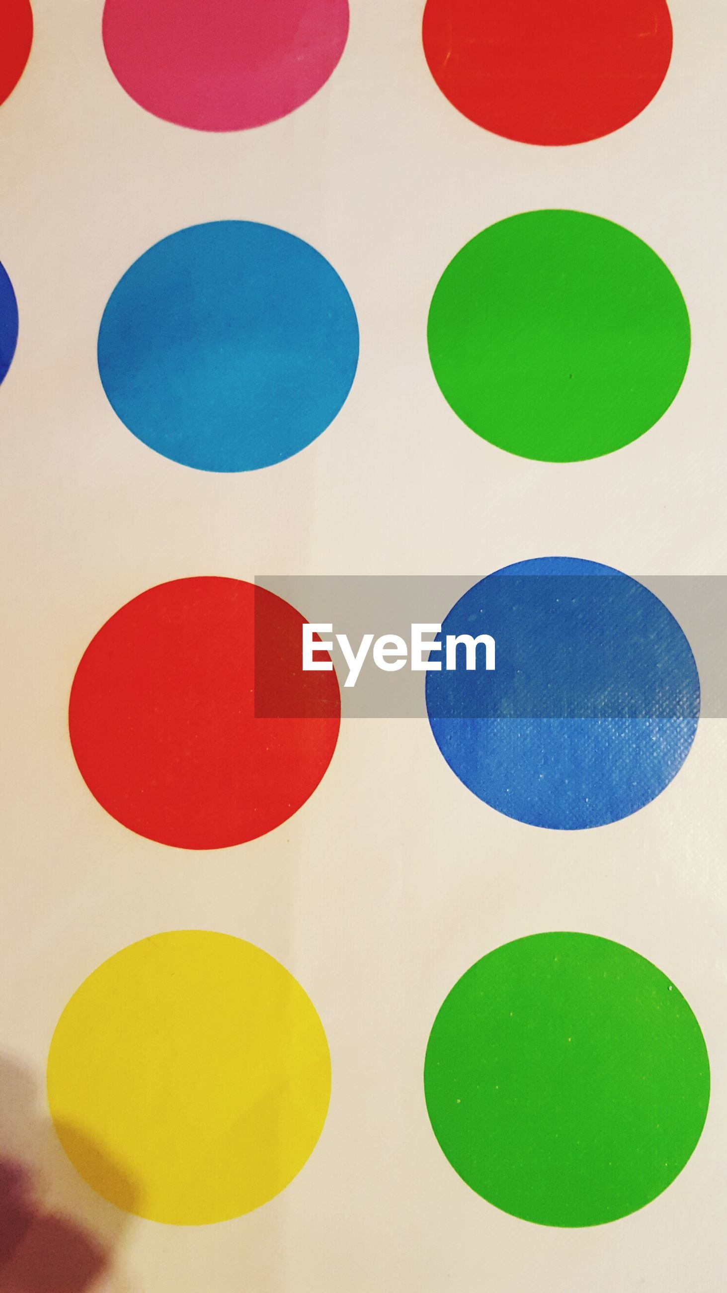 Full frame shot of colorful circles on white wall