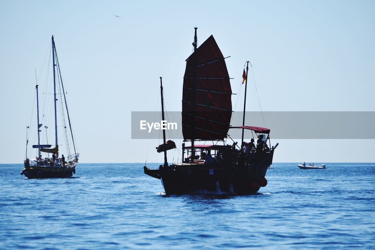 nautical vessel, water, transportation, sea, mode of transportation, sky, sailboat, waterfront, sailing, clear sky, nature, travel, real people, mast, day, pole, group of people, scenics - nature, incidental people, outdoors, horizon over water