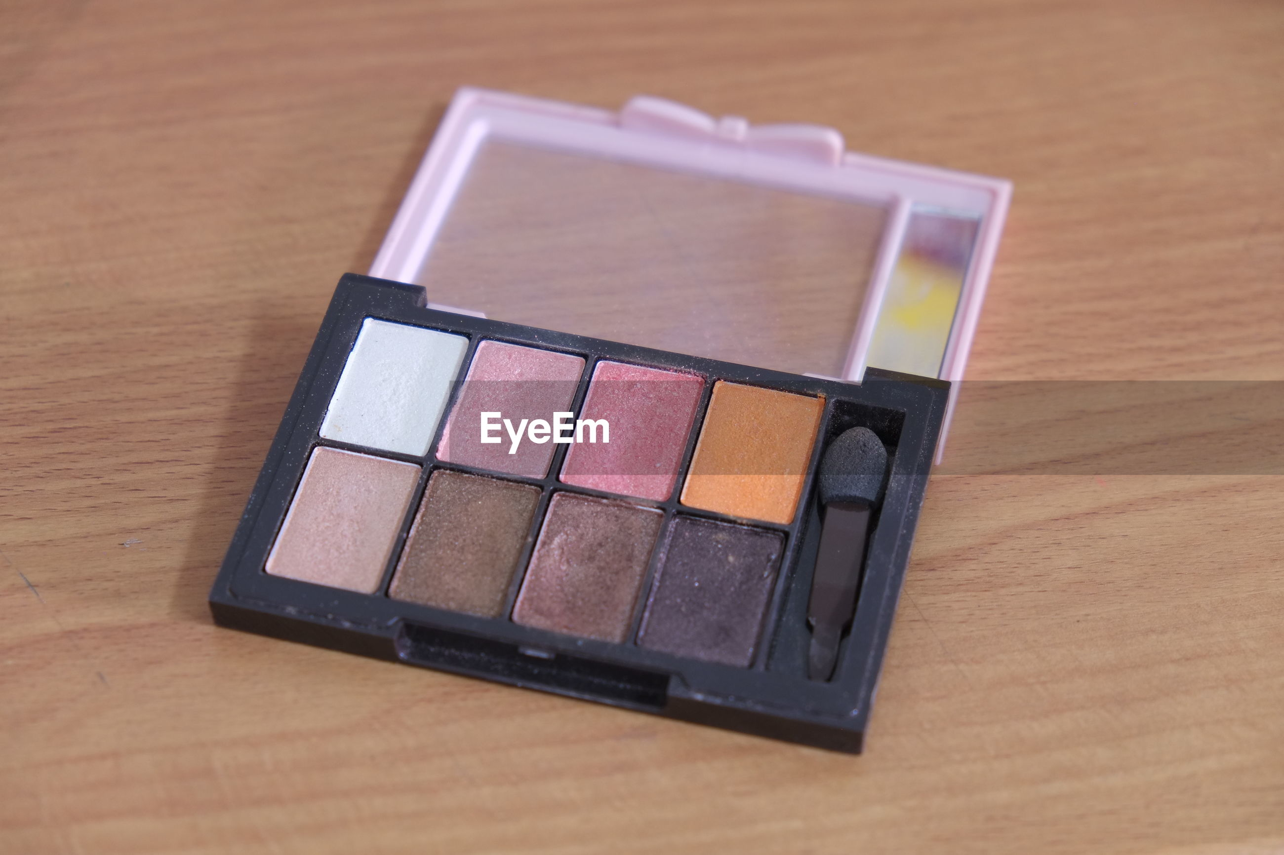 High angle view of eyeshadow pallet on table