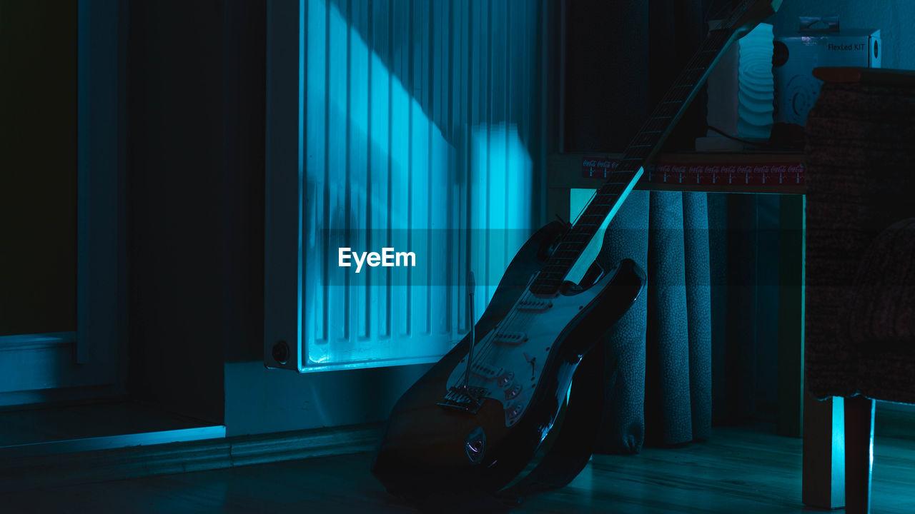 Guitar In Darkroom At Home