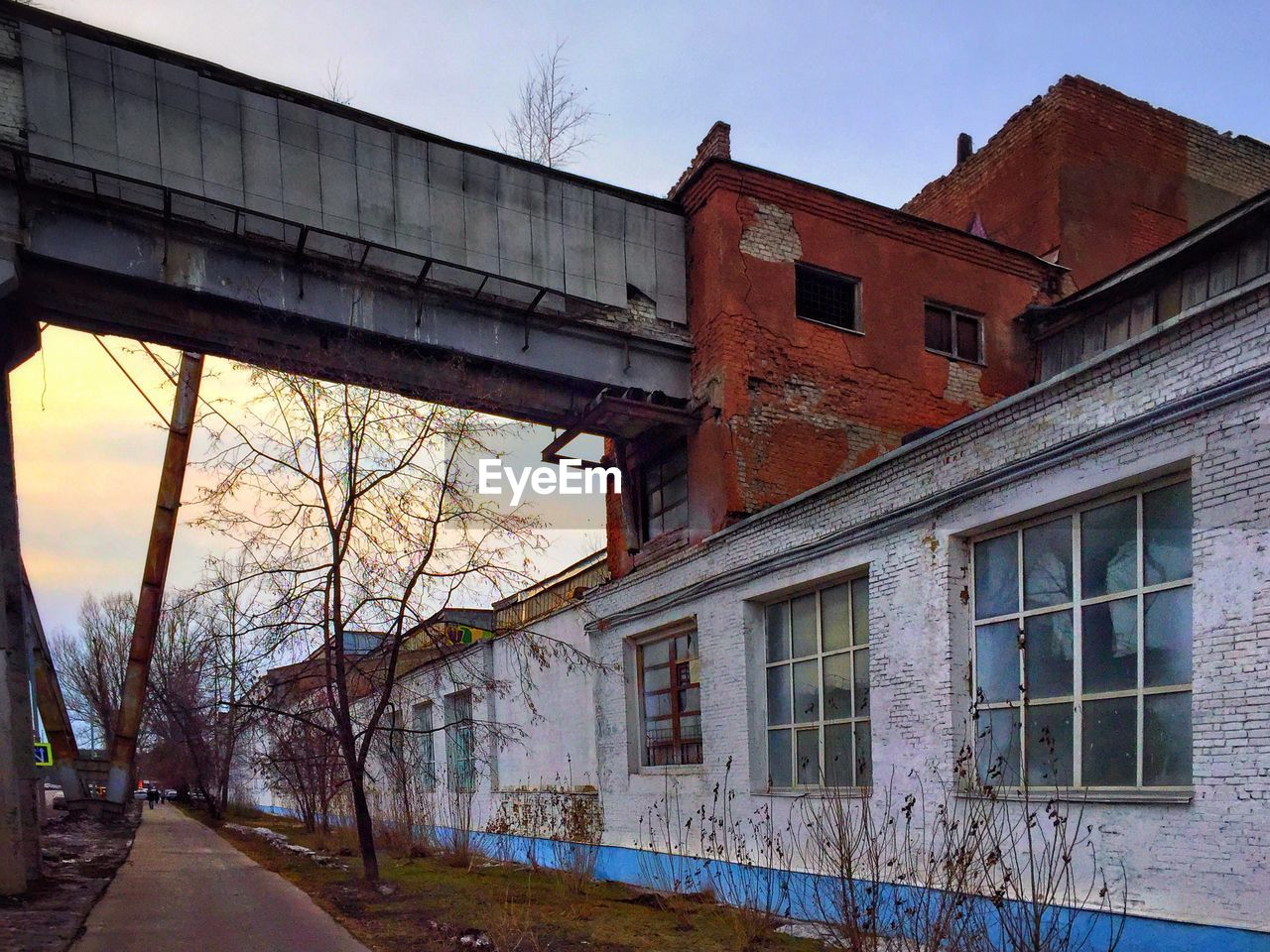 built structure, architecture, building exterior, window, building, sky, old, bare tree, no people, nature, tree, transportation, day, low angle view, plant, outdoors, bridge, abandoned, bridge - man made structure, house, architectural column