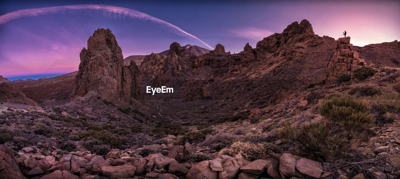 scenics - nature, sky, beauty in nature, tranquil scene, tranquility, rock, mountain, nature, non-urban scene, environment, rock - object, rock formation, cloud - sky, solid, landscape, no people, idyllic, travel destinations, sunset, low angle view, outdoors, formation, climate, arid climate, purple, eroded