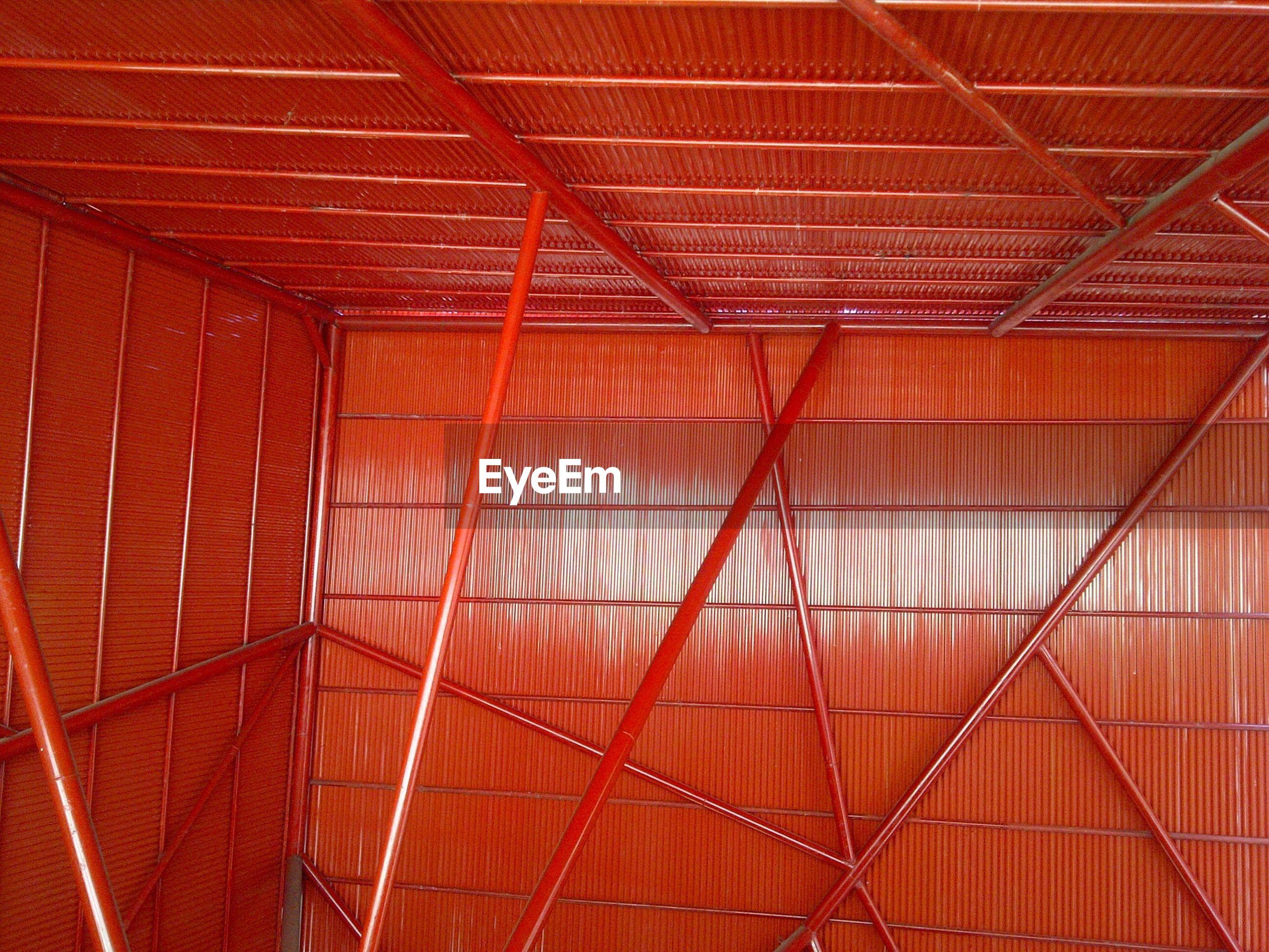 Orange room with poles