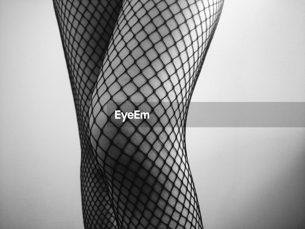 Midsection Of Woman Wearing Fishnet Stockings