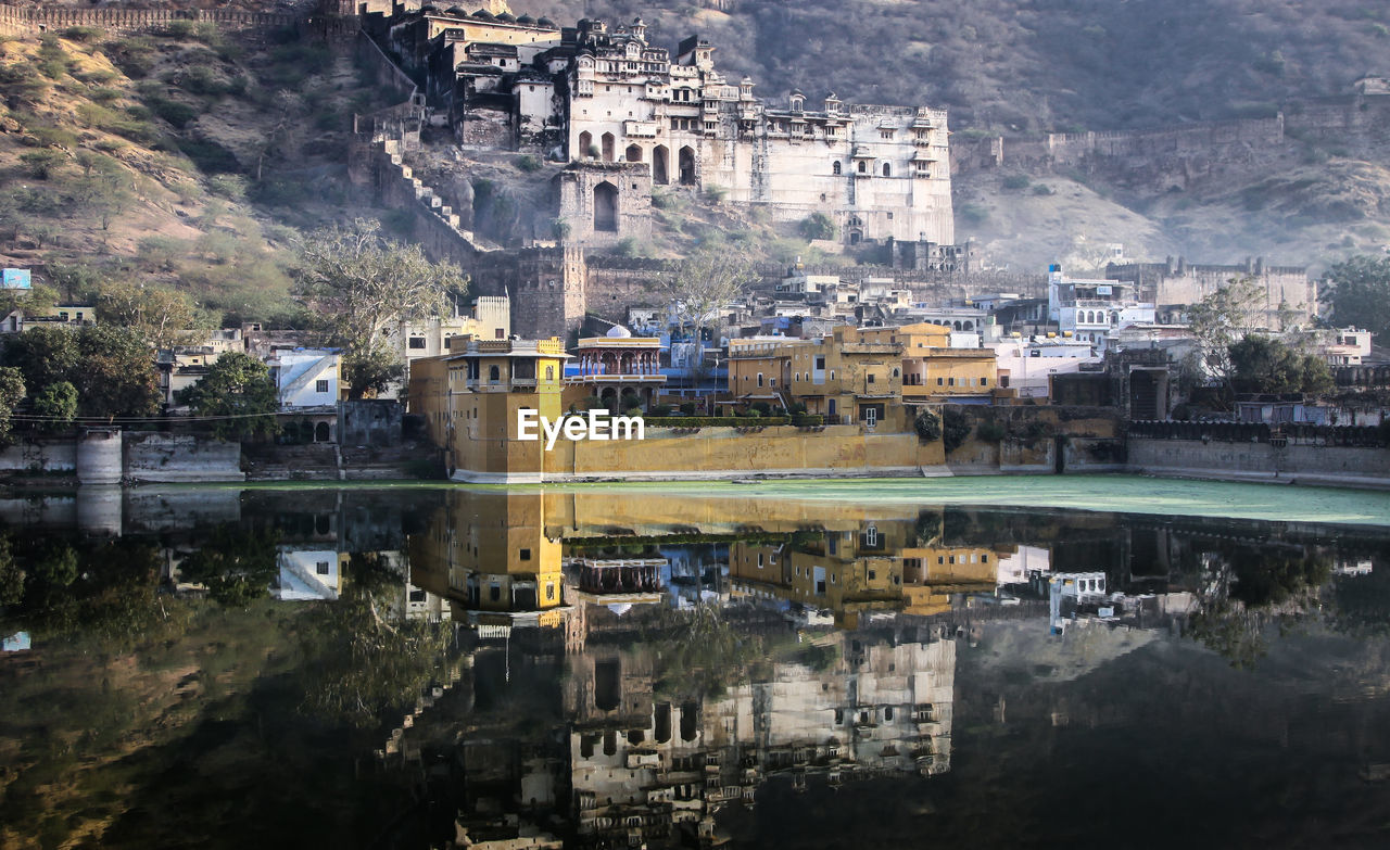 Historic buildings reflected in lake