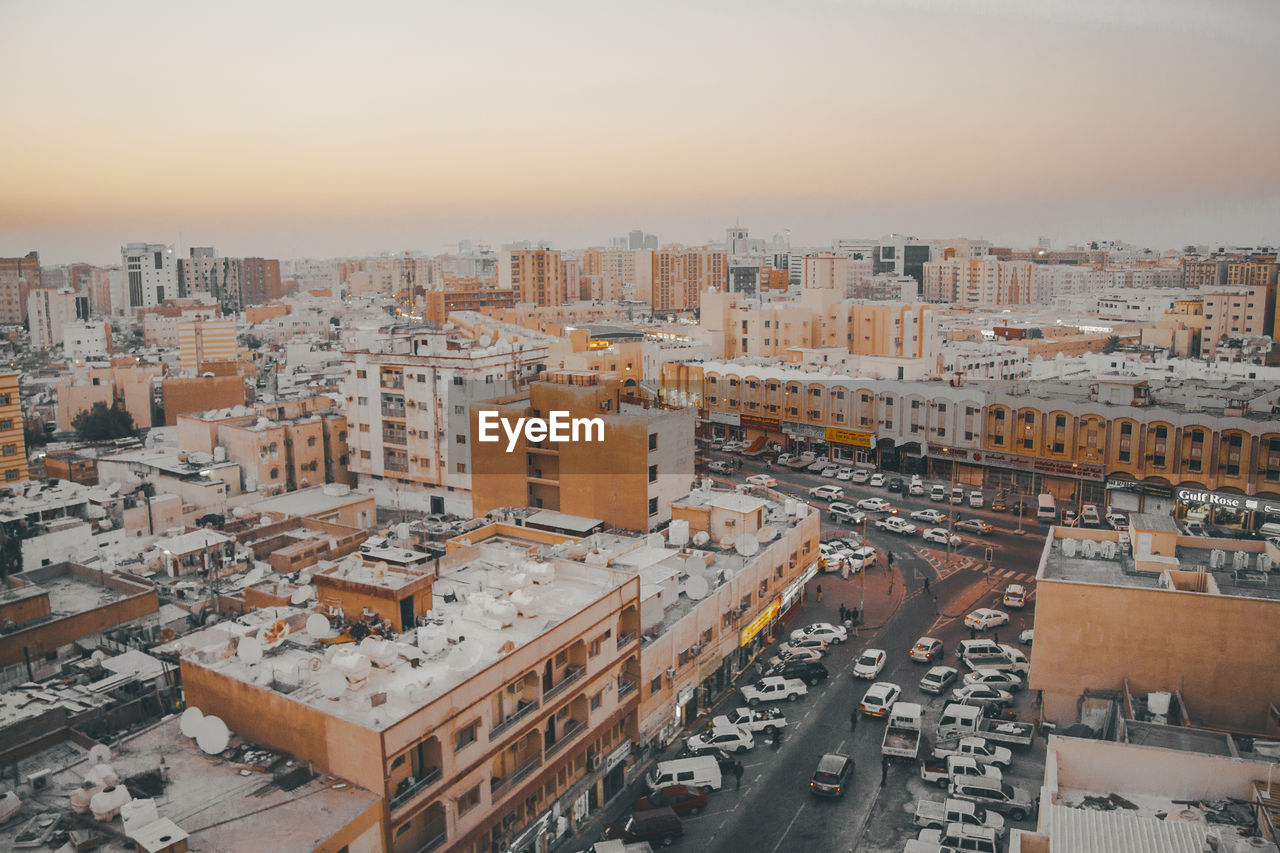 building exterior, architecture, city, built structure, high angle view, sky, residential district, building, cityscape, street, transportation, motor vehicle, car, road, mode of transportation, no people, nature, land vehicle, day, outdoors, apartment, settlement
