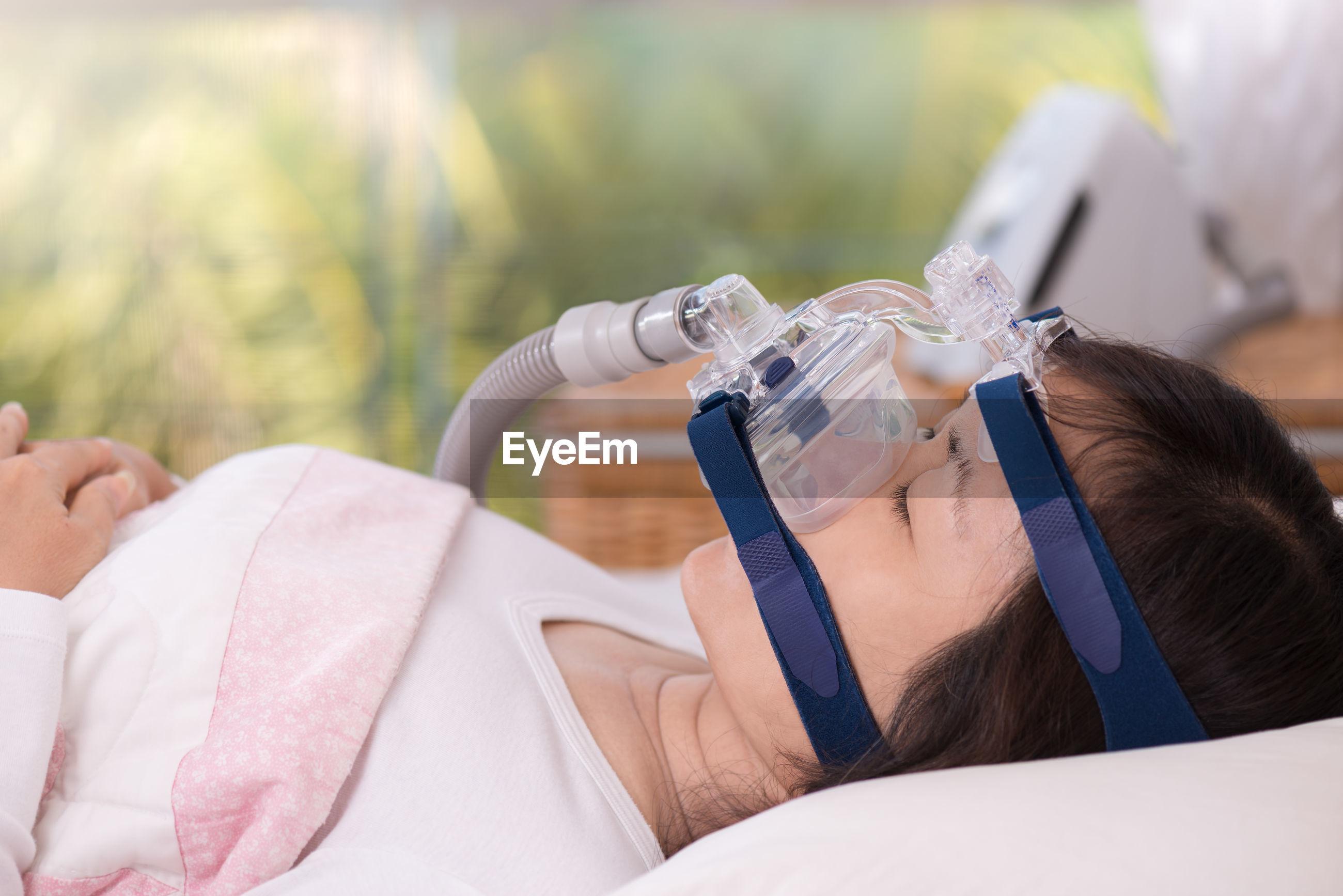 Side view of woman taking apnea treatment