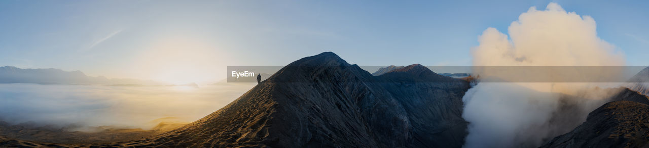 Panoramic view of man standing on mountain