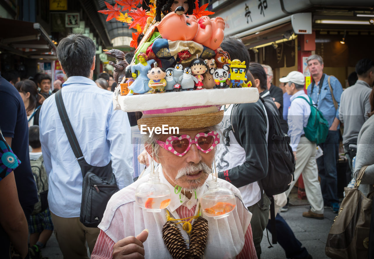 men, large group of people, real people, leisure activity, enjoyment, celebration, lifestyles, traditional festival, women, day, outdoors, crowd, adult, people