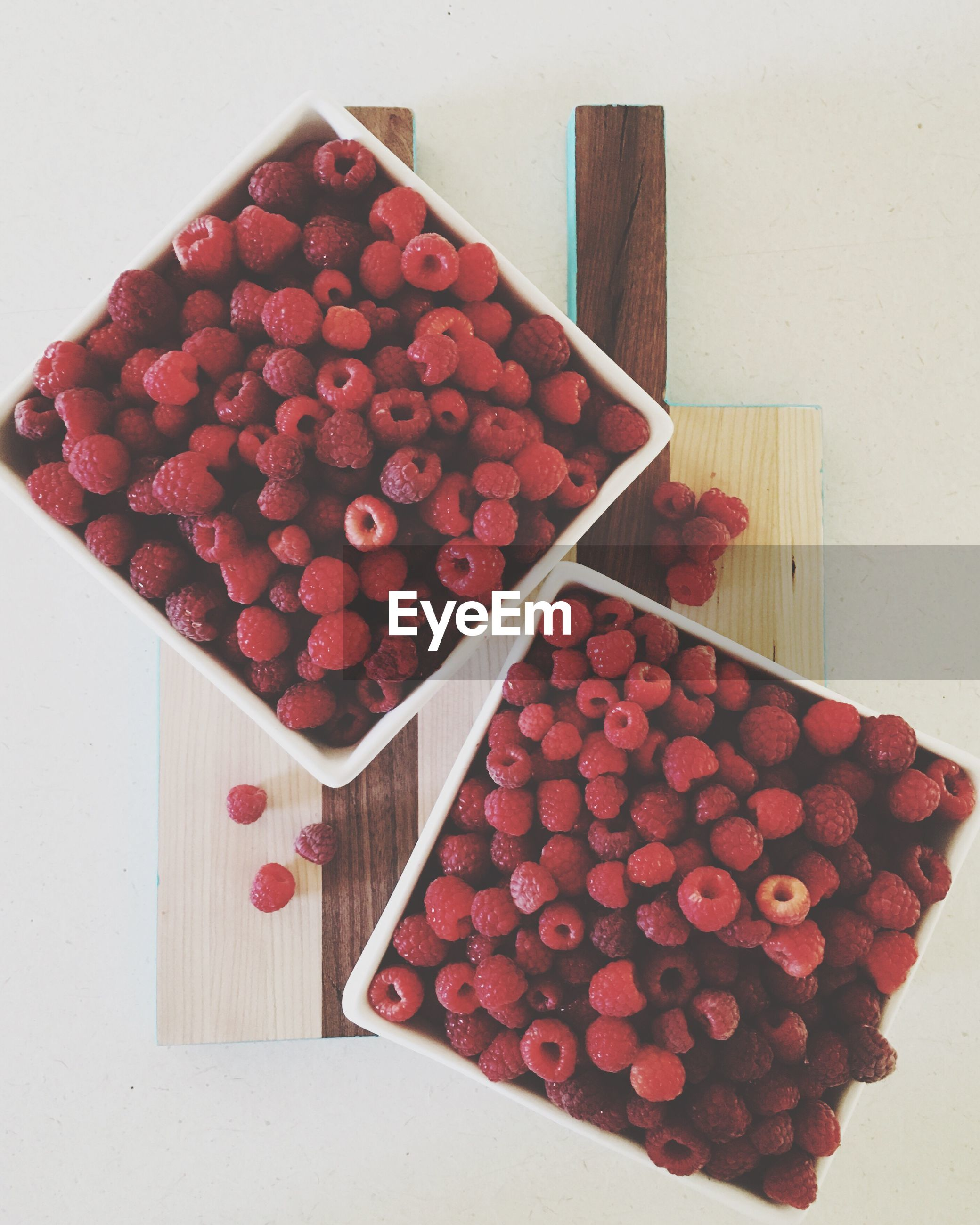 High angle view of raspberries in boxes on table