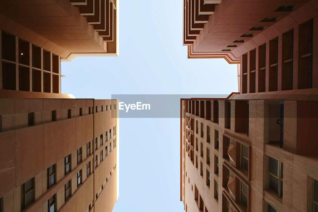 Directly Below Of Buildings Against Clear Sky