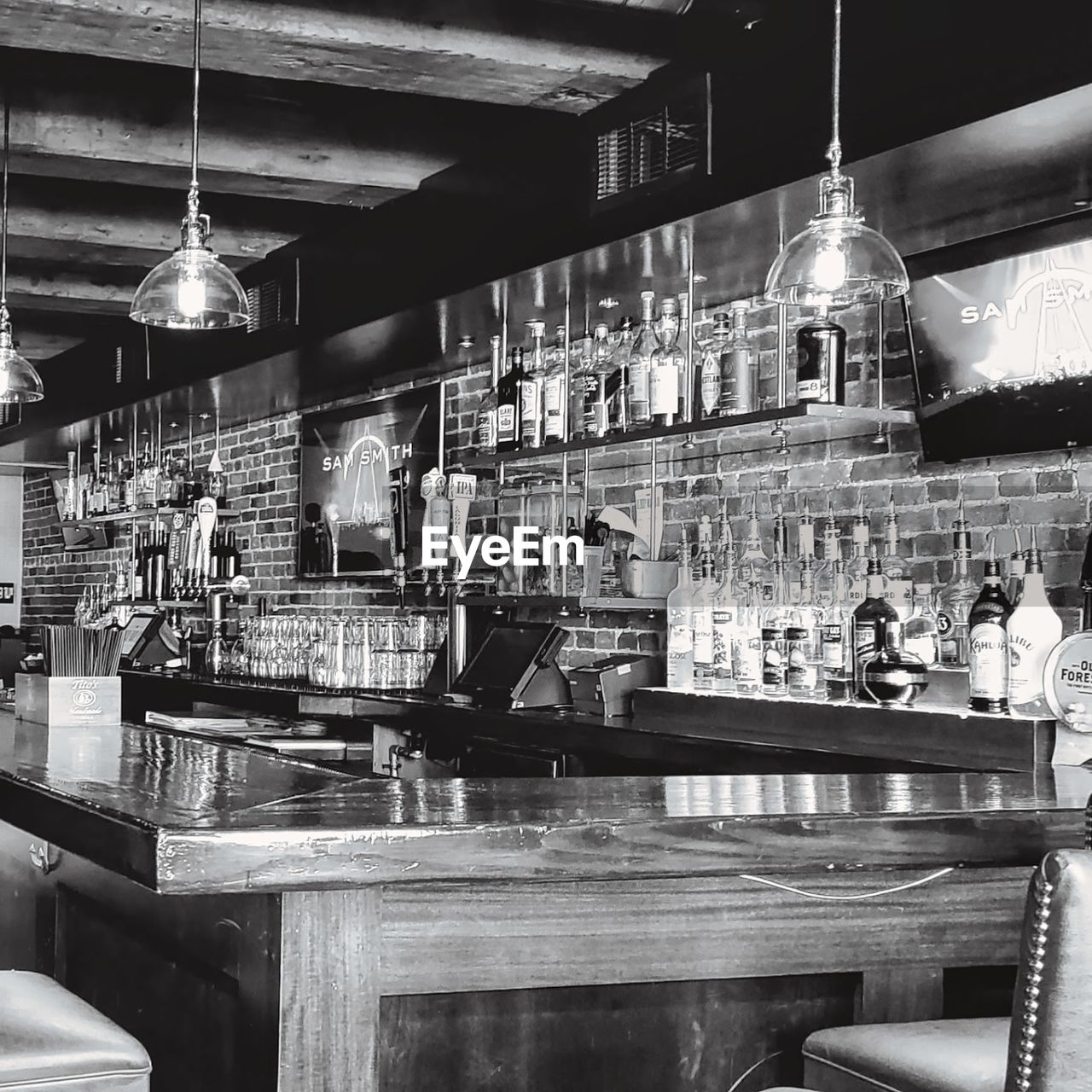 bar - drink establishment, restaurant, food and drink, business, bar counter, indoors, table, drink, refreshment, incidental people, illuminated, adult, lighting equipment, real people, men, sitting, container, people, group, group of people, bartender