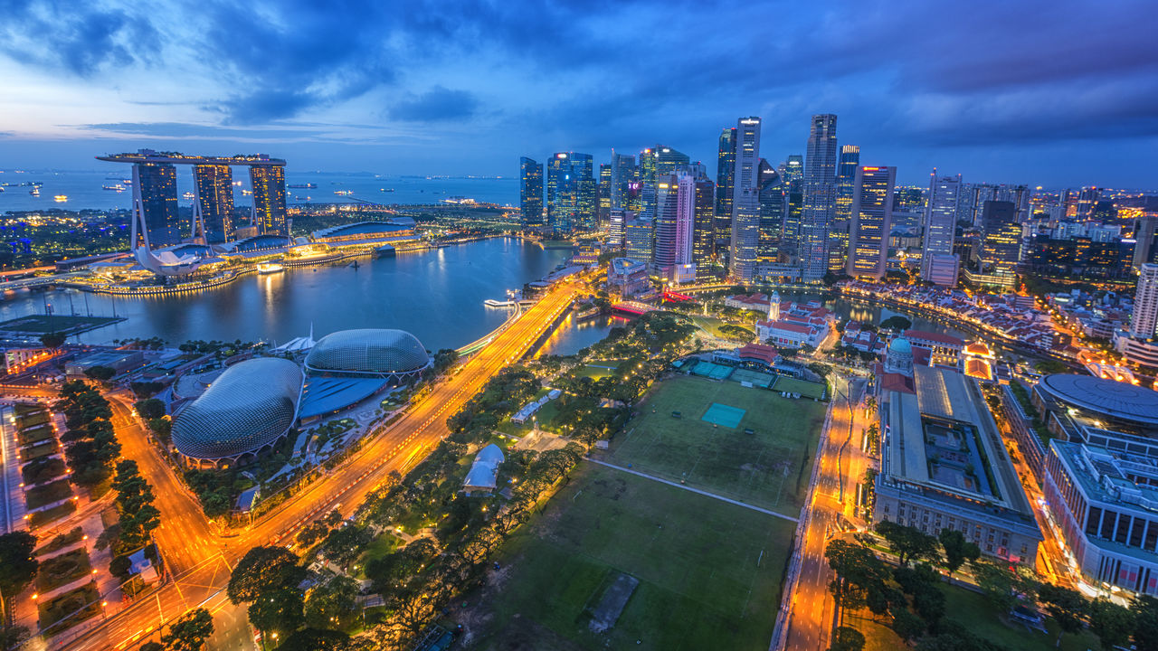 building exterior, architecture, built structure, city, sky, cloud - sky, cityscape, illuminated, building, water, nature, high angle view, transportation, office building exterior, dusk, residential district, modern, night, skyscraper, no people, outdoors, financial district