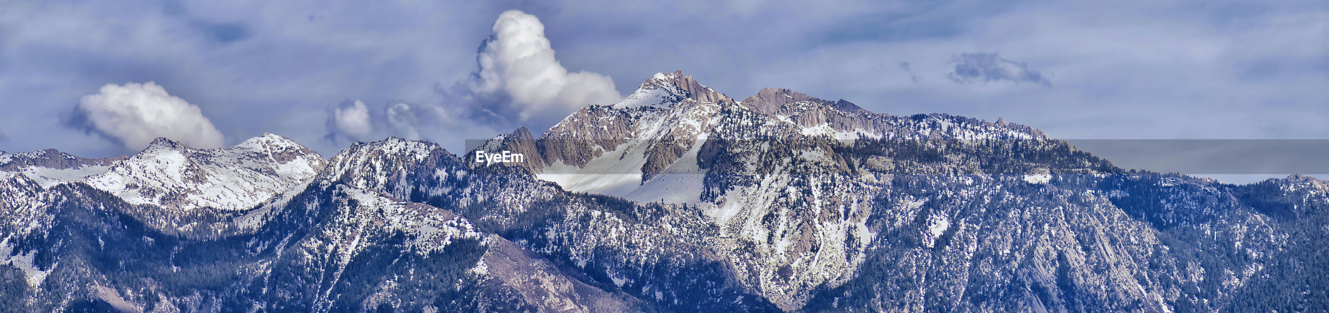 PANORAMIC SHOT OF SNOWCAPPED MOUNTAIN AGAINST SKY