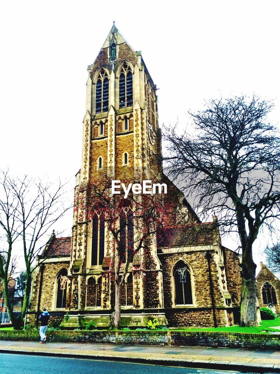 architecture, place of worship, religion, built structure, building exterior, bare tree, low angle view, tower, spirituality, travel destinations, day, history, tree, outdoors, sky, no people, clock tower, clear sky, branch