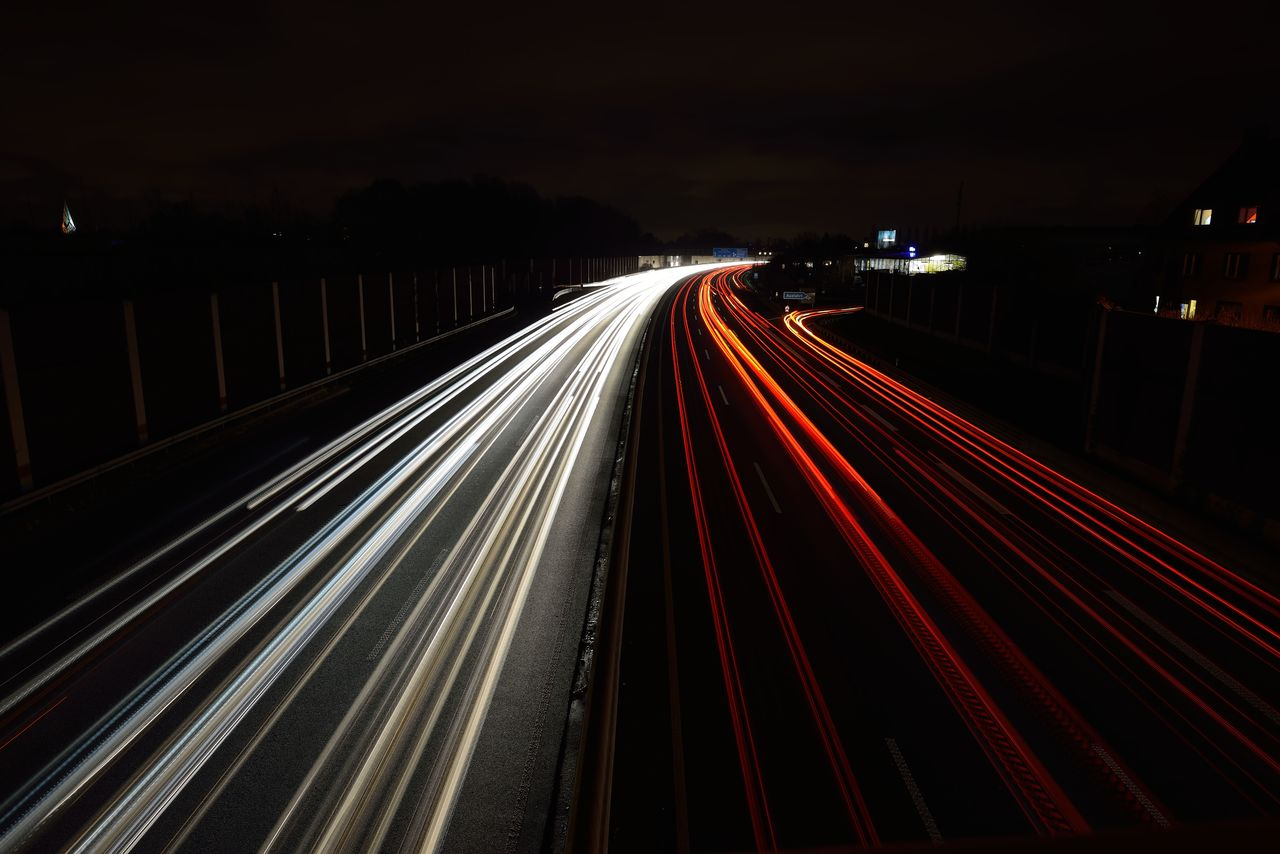 long exposure, motion, illuminated, light trail, night, speed, blurred motion, road, transportation, city, high angle view, architecture, no people, street, glowing, red, highway, traffic, lighting equipment, the way forward, outdoors, multiple lane highway, vehicle light