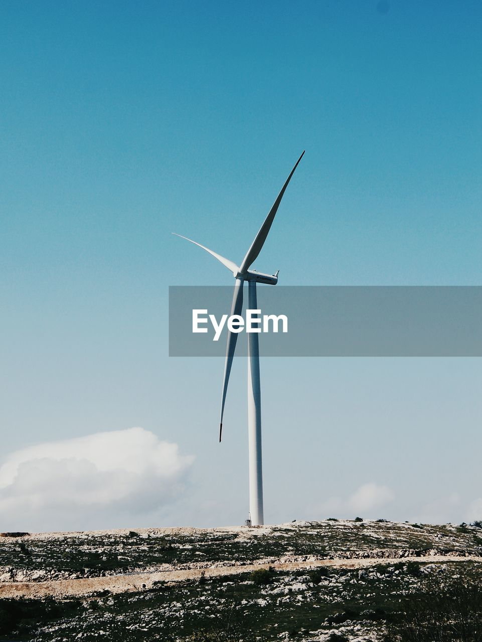sky, wind turbine, environmental conservation, renewable energy, fuel and power generation, alternative energy, turbine, wind power, environment, blue, nature, day, low angle view, no people, landscape, outdoors, copy space, technology, cloud - sky, beauty in nature, sustainable resources