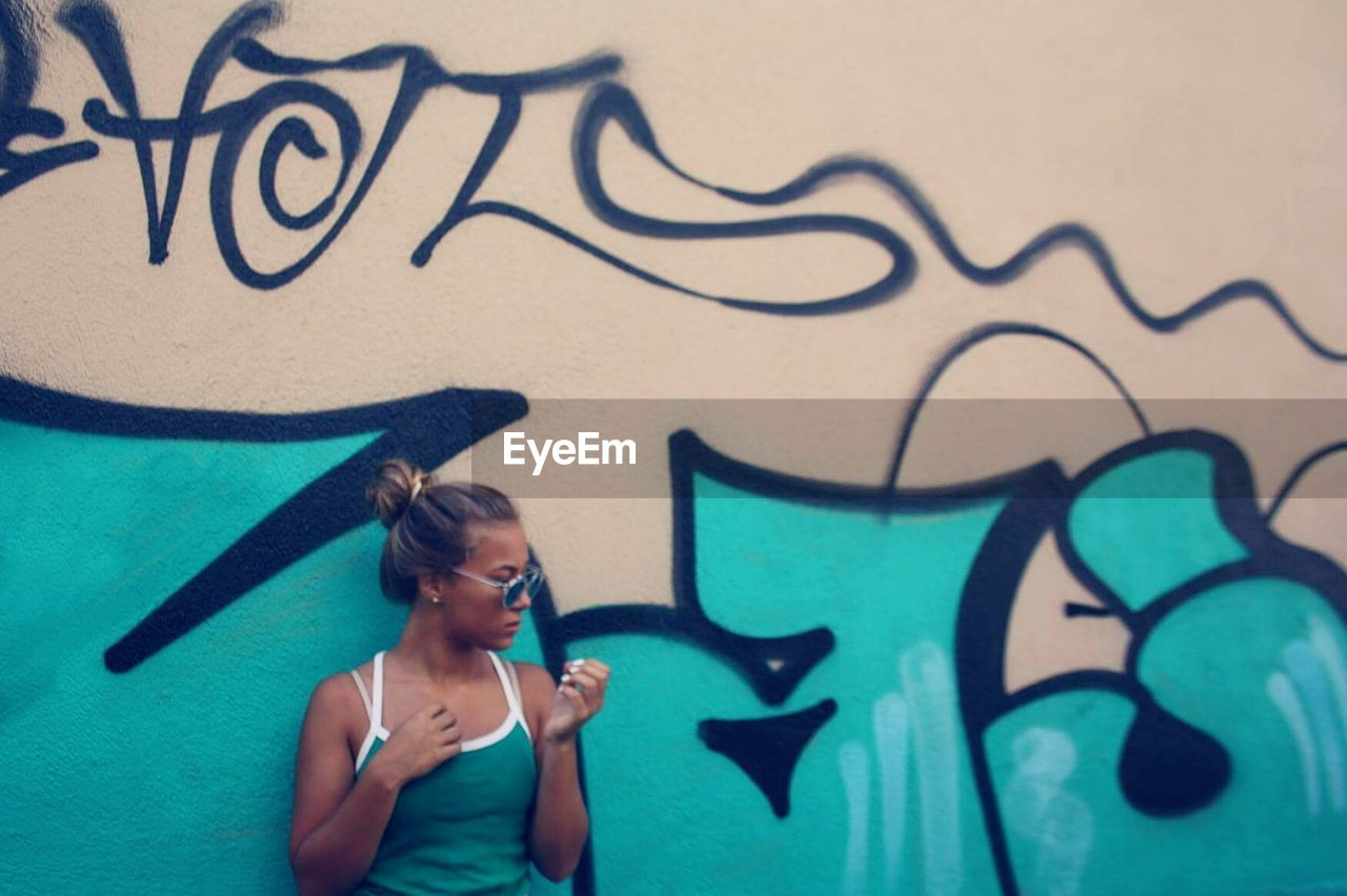 graffiti, street art, young adult, teenager, one person, standing, day, outdoors, young women, people, one young woman only, adult, adults only