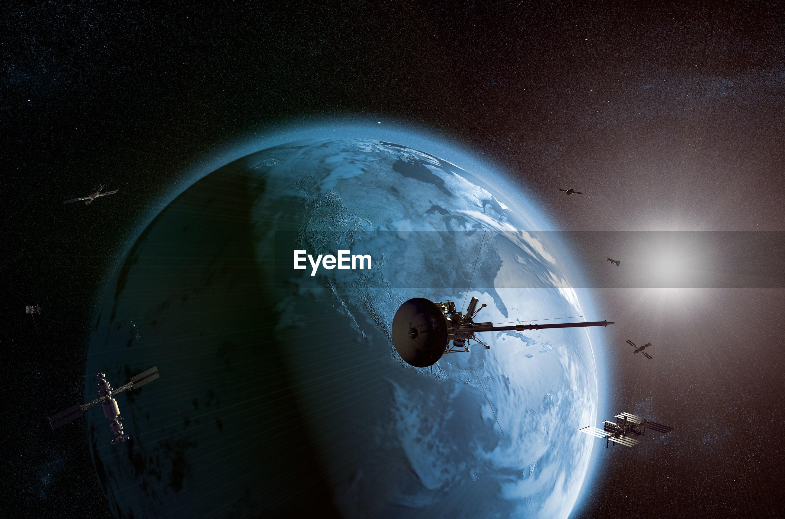 Satellite flying against earth
