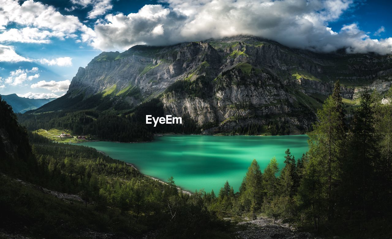 mountain, scenics - nature, beauty in nature, tranquil scene, tranquility, cloud - sky, water, sky, non-urban scene, nature, green color, no people, idyllic, mountain range, lake, plant, tree, landscape, day, outdoors, turquoise colored, formation, mountain peak