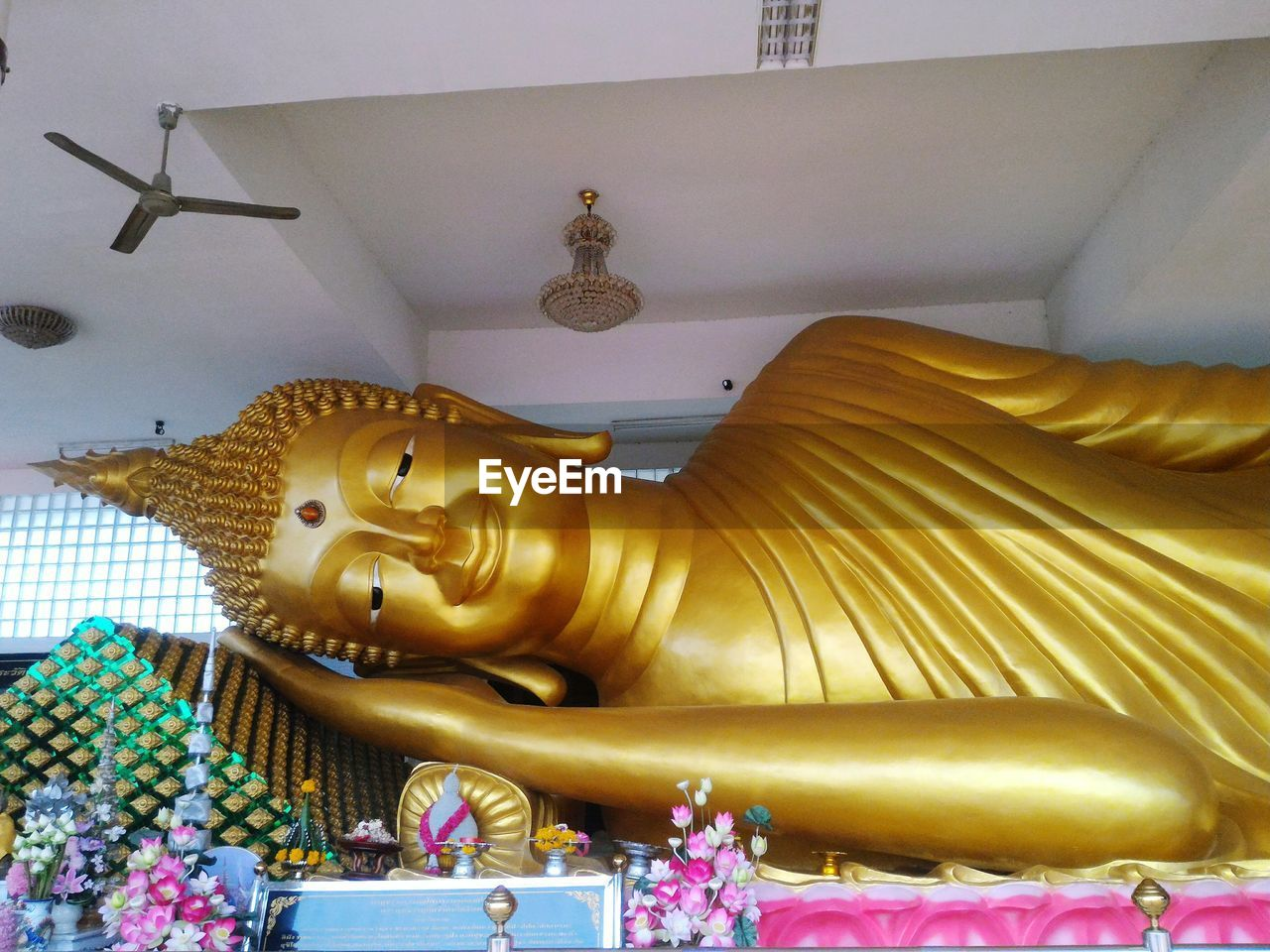 statue, spirituality, religion, gold colored, human representation, sculpture, art and craft, male likeness, place of worship, low angle view, no people, indoors, travel destinations, day, close-up