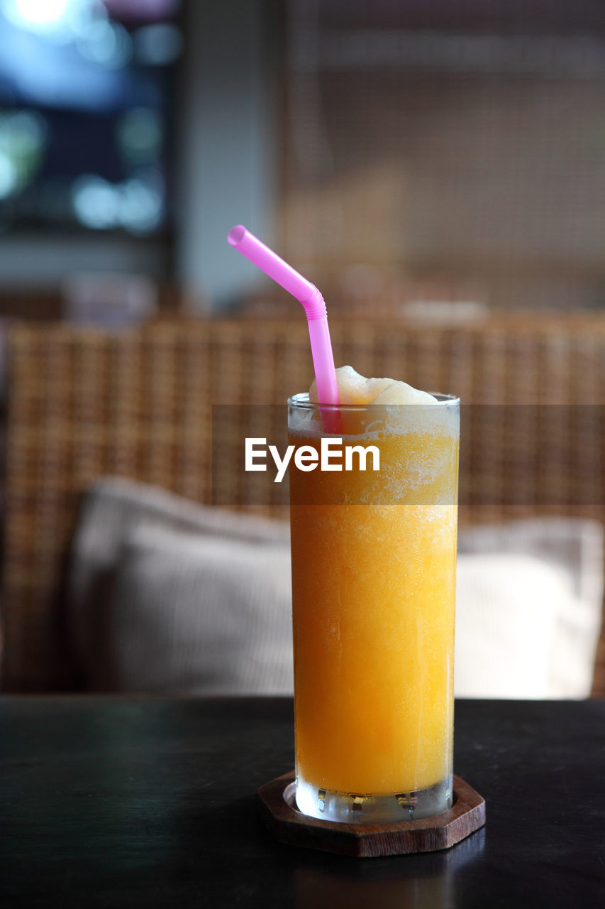 food and drink, drink, refreshment, freshness, table, drinking glass, food, glass, household equipment, focus on foreground, drinking straw, straw, close-up, still life, indoors, healthy eating, no people, wellbeing, fruit, smoothie, temptation