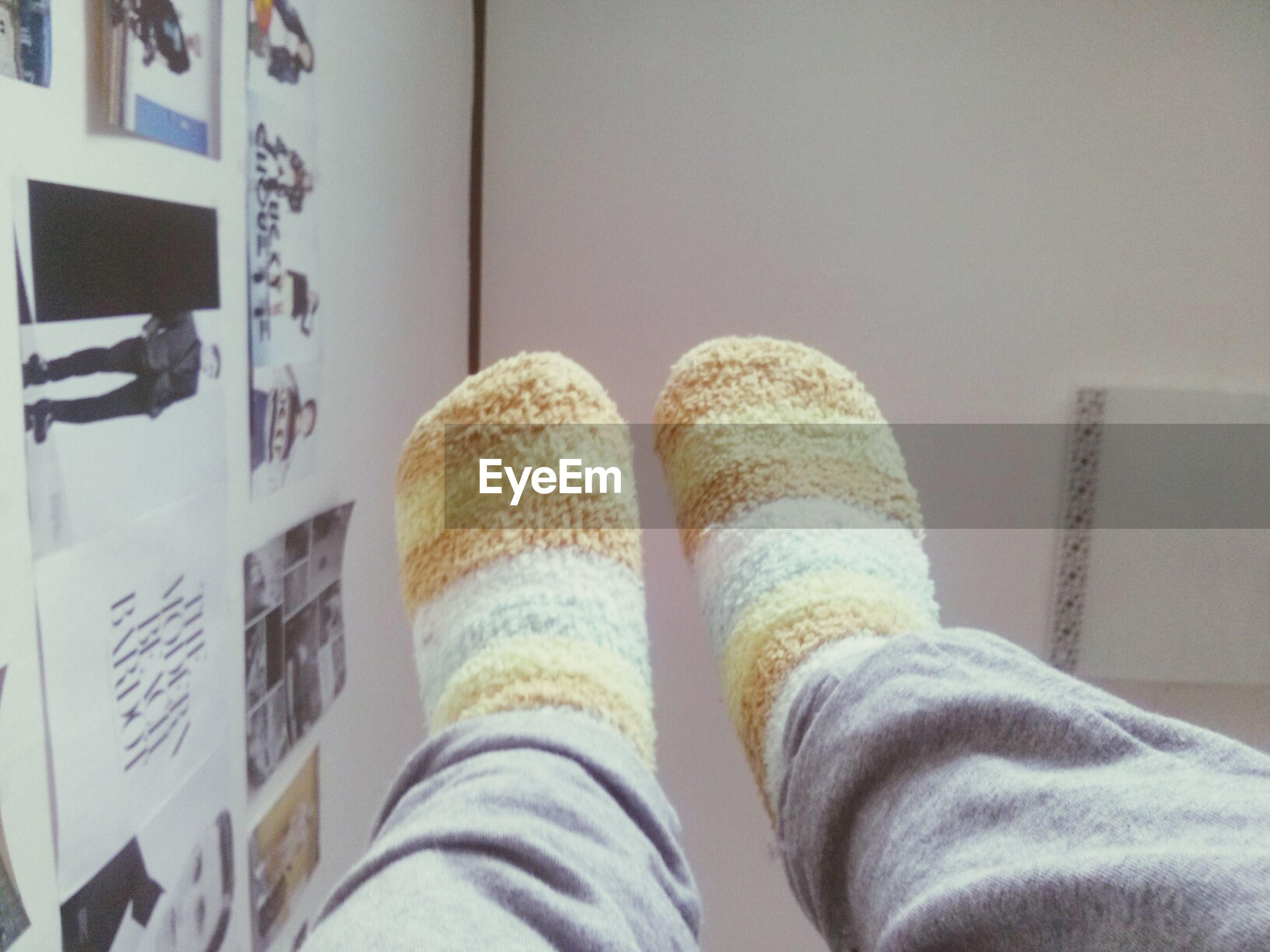 indoors, person, low section, personal perspective, home interior, lifestyles, shoe, men, leisure activity, bed, casual clothing, standing, human foot, wall - building feature, part of, domestic life, unrecognizable person