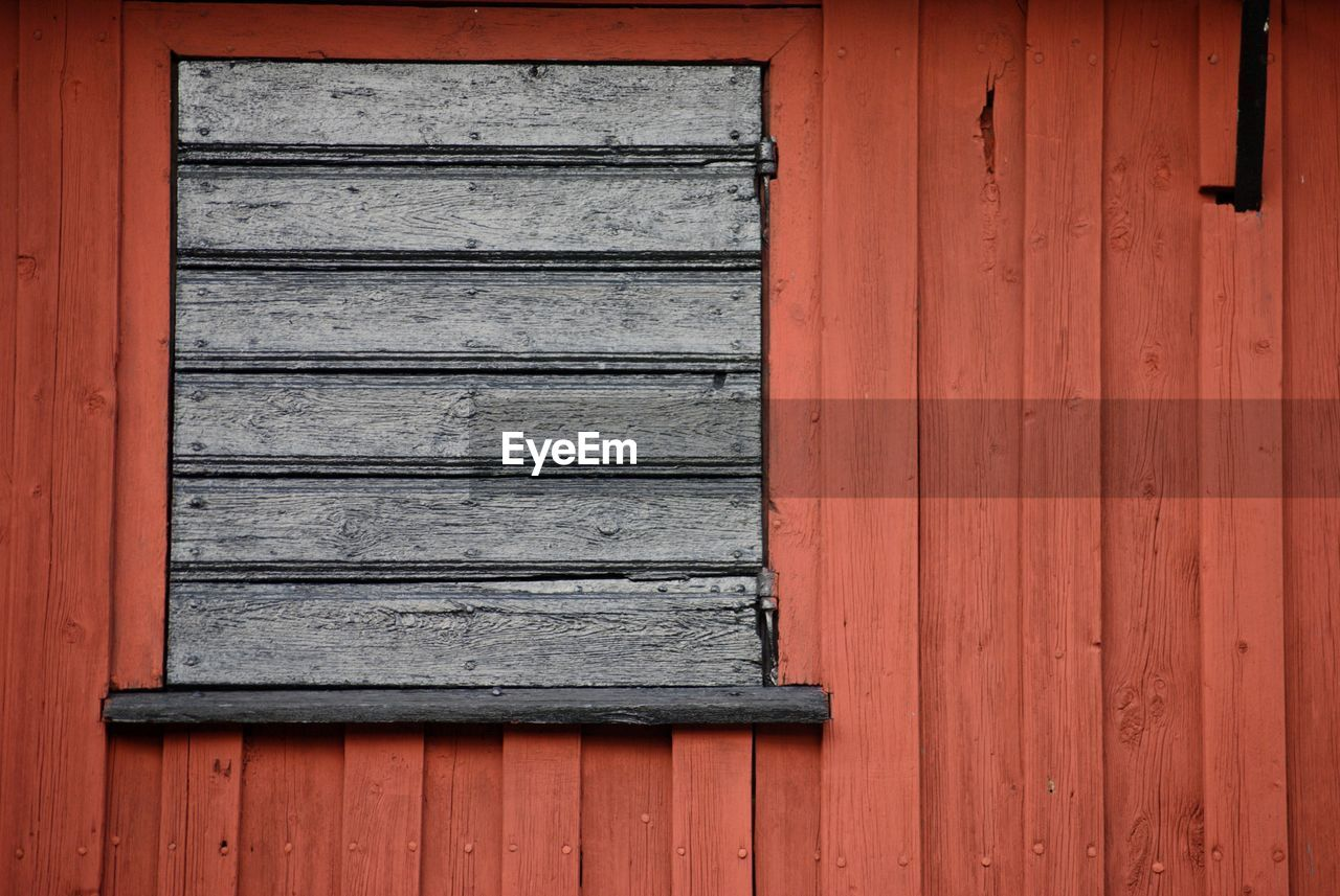 wood - material, architecture, built structure, no people, pattern, day, safety, closed, security, building exterior, protection, building, house, window, wall - building feature, door, entrance, outdoors, red, wood, corrugated, garage
