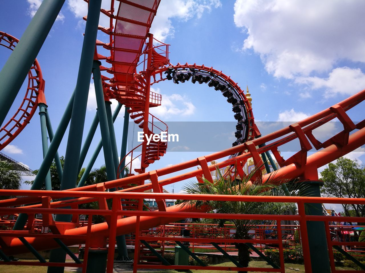 amusement park, amusement park ride, sky, arts culture and entertainment, leisure activity, metal, low angle view, built structure, architecture, rollercoaster, day, enjoyment, fun, nature, cloud - sky, excitement, red, fairground, real people, lifestyles, positive emotion, outdoors, jungle gym