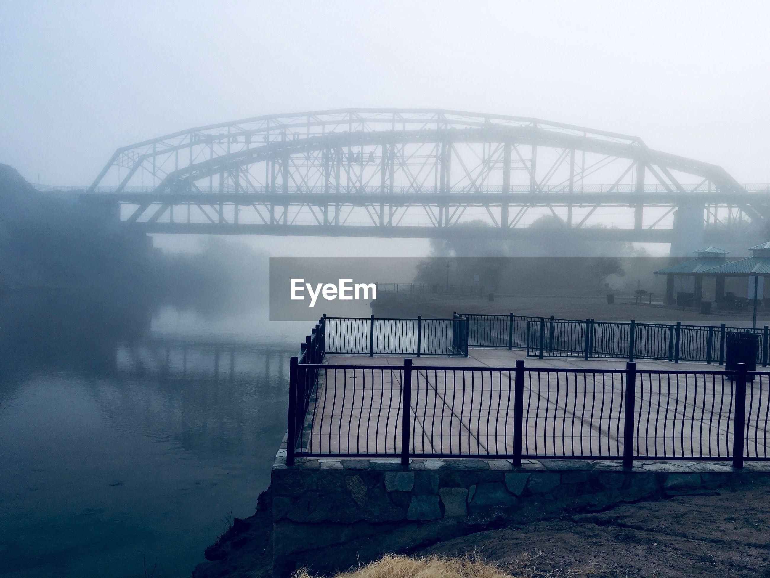 fog, architecture, built structure, connection, bridge, water, bridge - man made structure, nature, no people, sky, transportation, day, railing, outdoors, arch, travel destinations, river, arch bridge