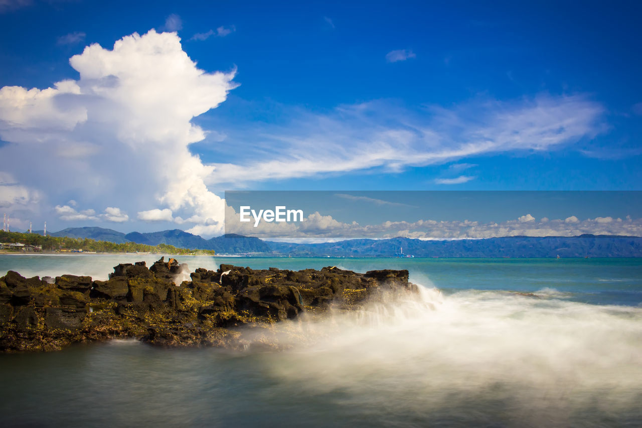 water, sky, cloud - sky, beauty in nature, sea, scenics - nature, tranquil scene, nature, motion, tranquility, land, no people, beach, idyllic, waterfront, outdoors, environment, day, blue, power in nature