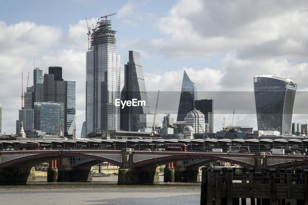 built structure, architecture, building exterior, city, office building exterior, sky, bridge, skyscraper, modern, cloud - sky, bridge - man made structure, connection, building, tall - high, transportation, tower, urban skyline, nature, landscape, day, no people, cityscape, outdoors, financial district