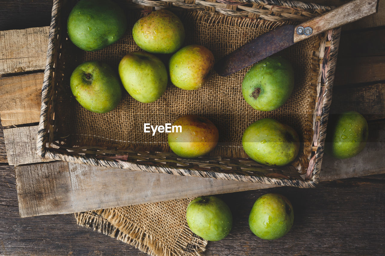 fruit, food and drink, healthy eating, wellbeing, food, container, freshness, basket, green color, still life, high angle view, wood - material, no people, indoors, apple - fruit, box, pear, large group of objects, crate, jute, apple, box - container, sour taste, orange