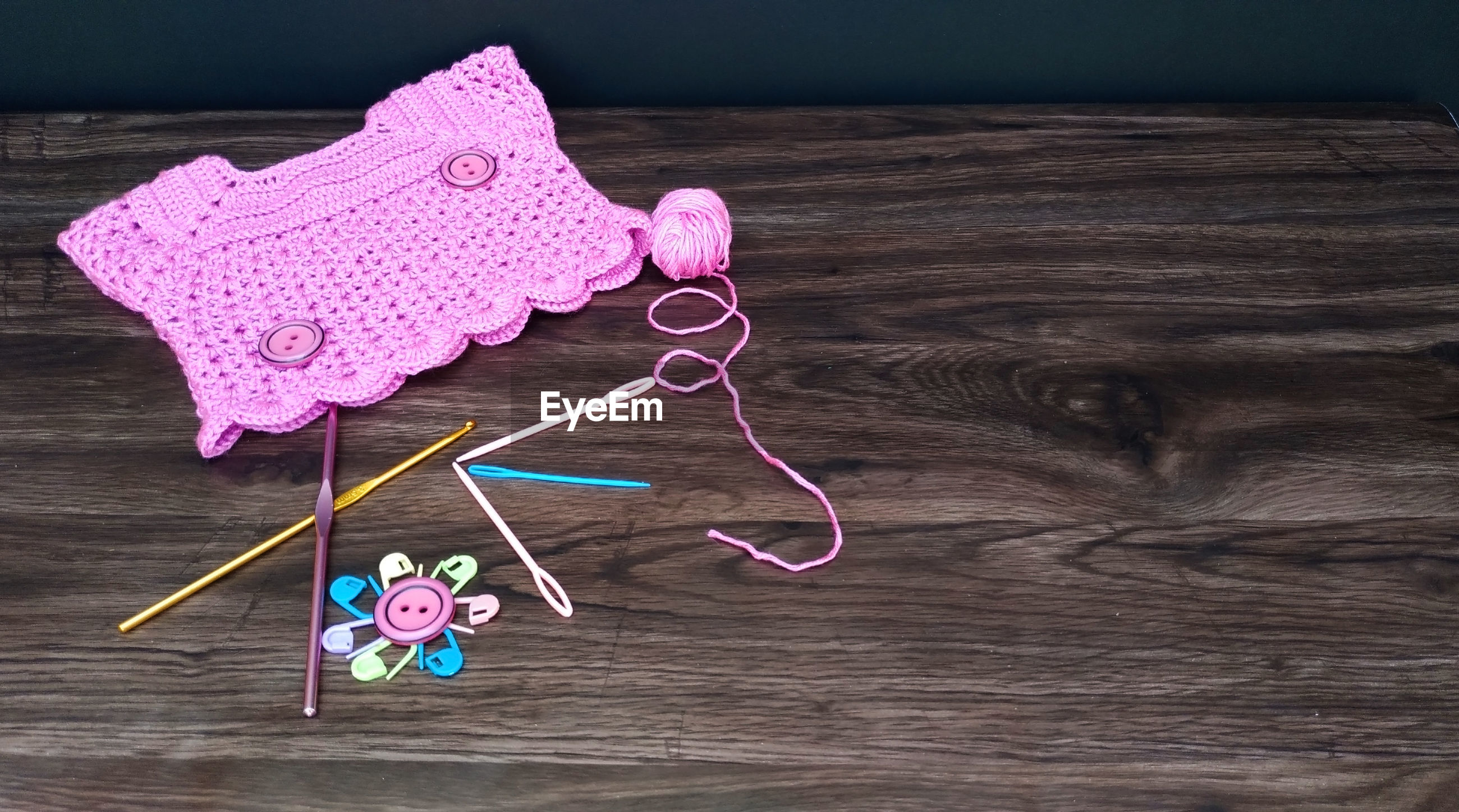 High angle view of crochet equipment on table