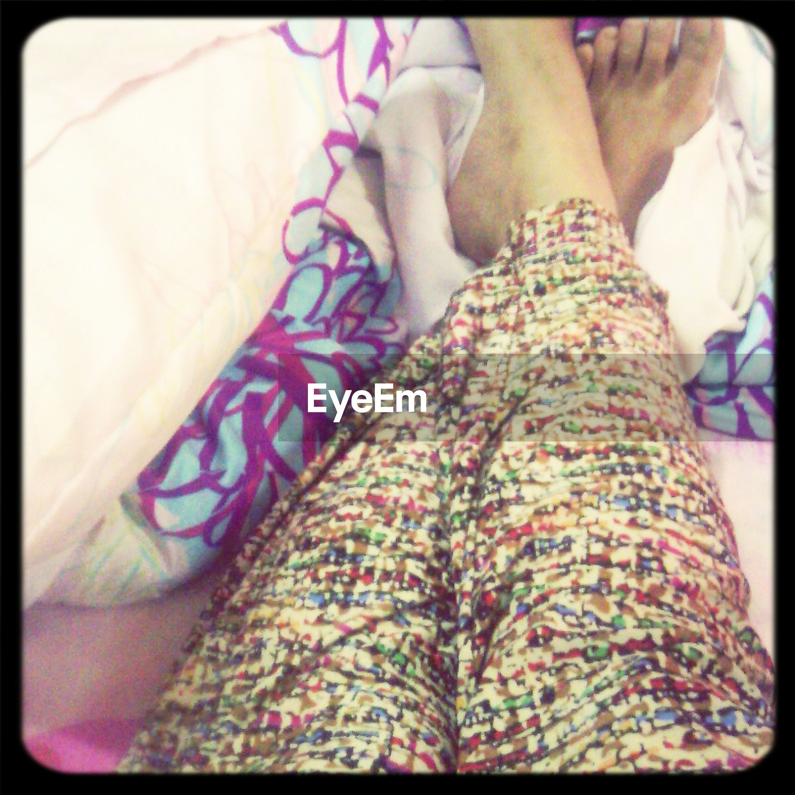 indoors, person, low section, lifestyles, transfer print, bed, midsection, barefoot, part of, leisure activity, human foot, auto post production filter, high angle view, relaxation
