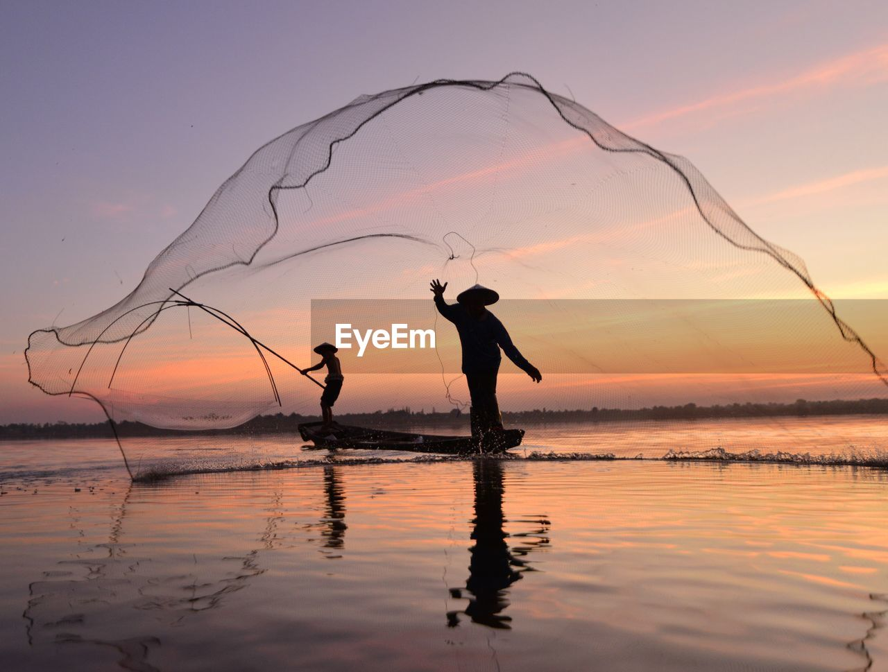 sunset, sky, water, real people, beauty in nature, scenics - nature, two people, orange color, lifestyles, silhouette, men, standing, people, land, beach, nature, reflection, leisure activity, waterfront, outdoors, fisherman, fishing industry