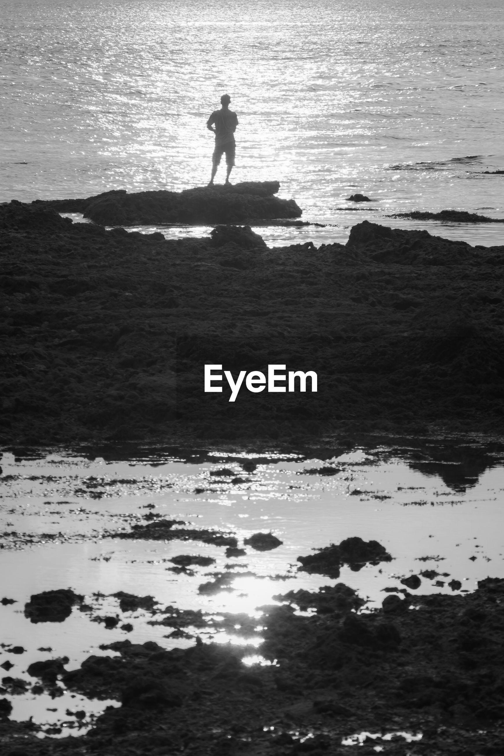 SILHOUETTE MAN AT BEACH
