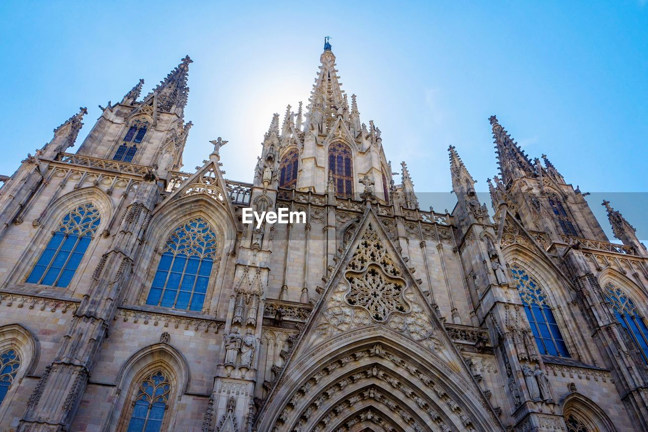 building exterior, architecture, low angle view, built structure, place of worship, religion, belief, building, spirituality, sky, no people, travel destinations, day, nature, the past, clear sky, arch, outdoors, gothic style, spire, ornate