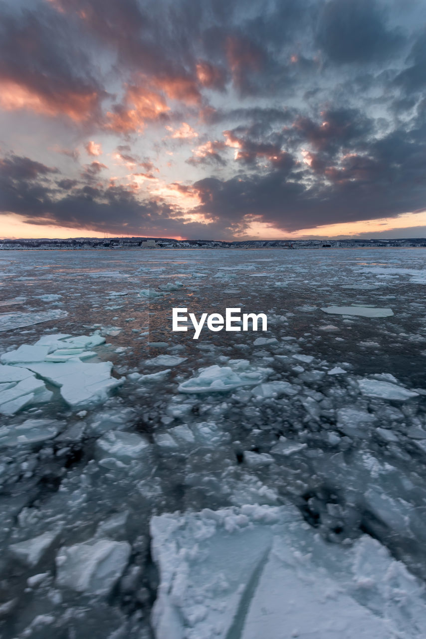 sunset, cloud - sky, cold temperature, sky, beauty in nature, winter, water, scenics - nature, tranquility, ice, tranquil scene, snow, frozen, nature, no people, sea, idyllic, orange color, horizon over water, outdoors, cold