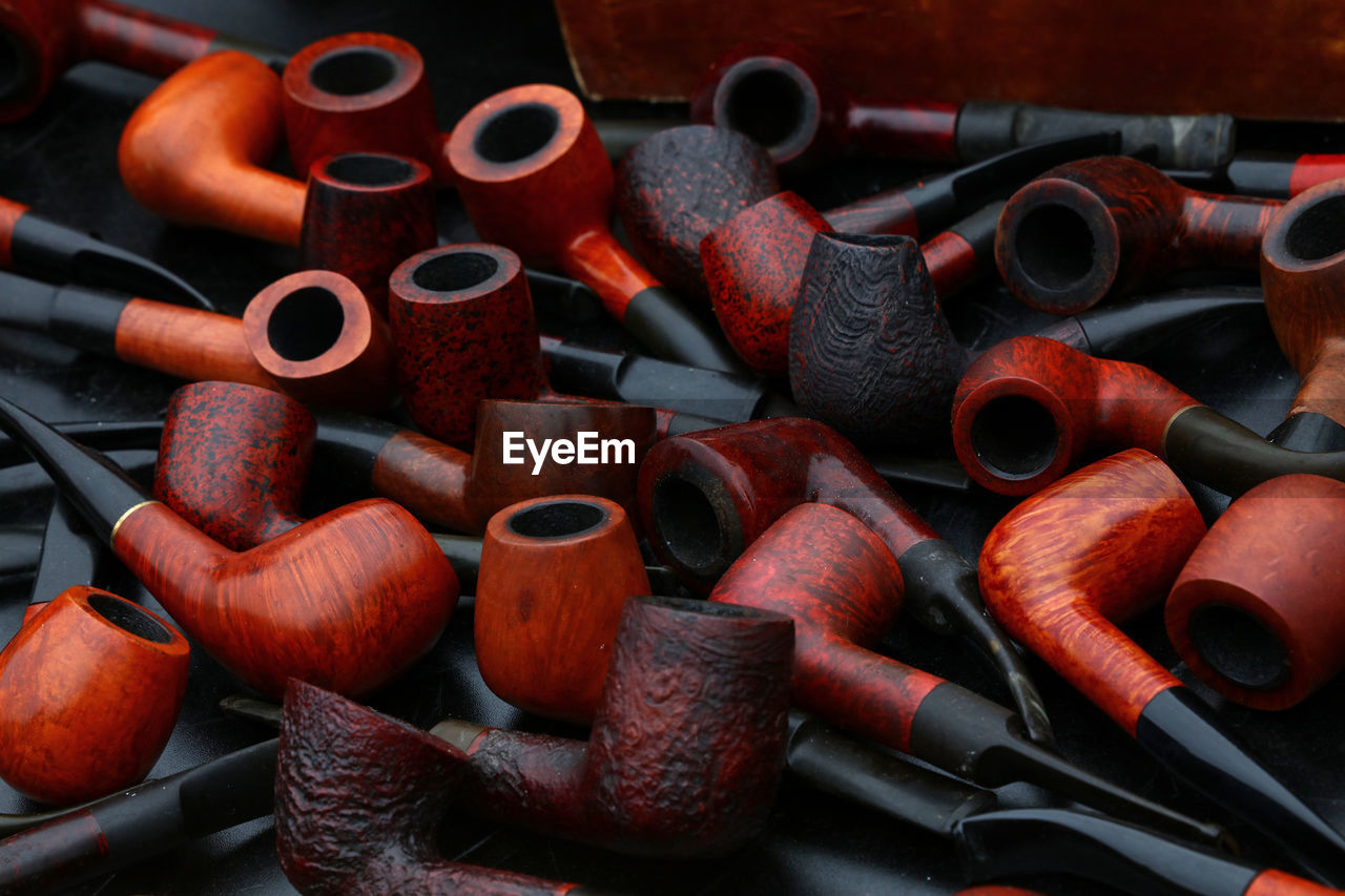 Close-Up Of Smoking Pipes On Table
